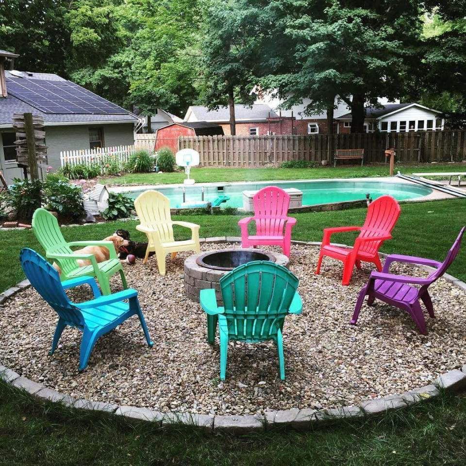 Stone Pit with a Rainbow of Chairs | Awesome Firepit Area Ideas For Your Outdoor Activities