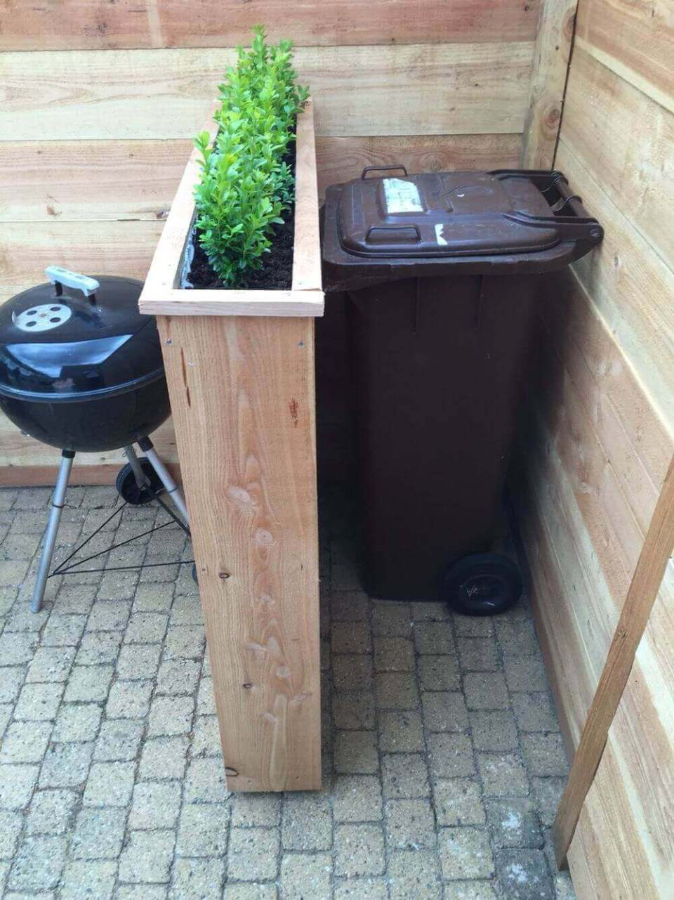 Lovely Raised Planters Hide Unsightly Bins | Outdoor Eyesore Hiding Ideas