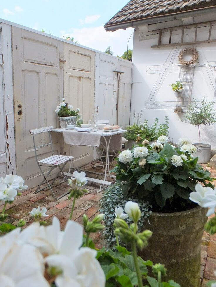 Reclaimed Doors make the Garden Wall | Creative Repurposed Old Door Ideas & Projects For Your Backyard
