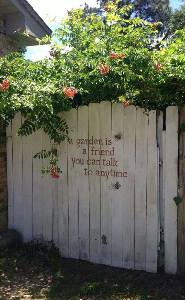 Stenciled Message on a Whitewashed Garden Gate | Funny DIY Garden Sign Ideas