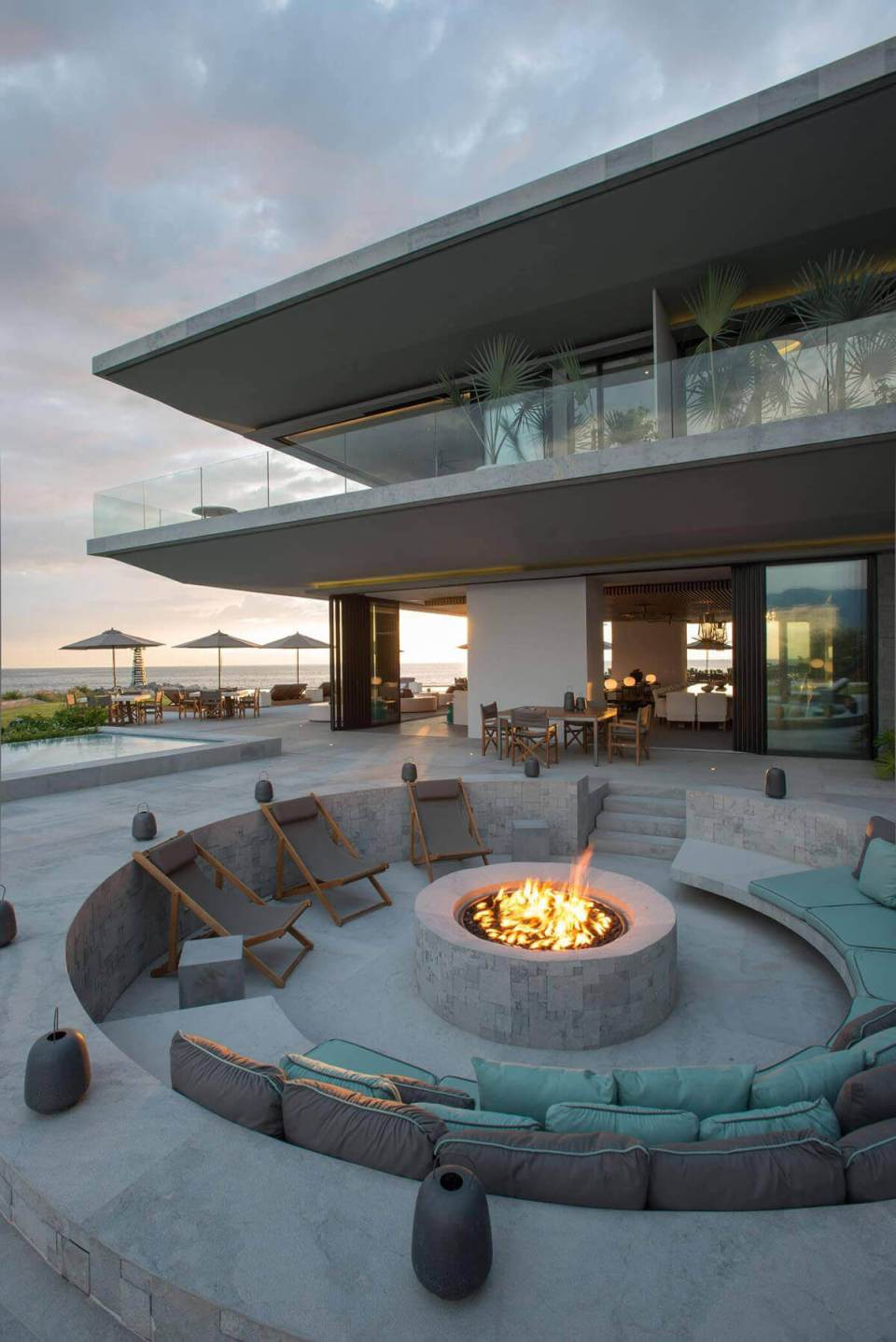 A Sunken Concrete Firepit with Comfortable Seating | Awesome Firepit Area Ideas For Your Outdoor Activities