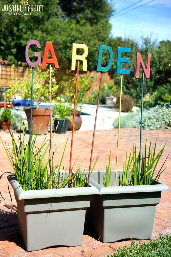 Letters Standing on Tall Posts   Funny DIY Garden Sign Ideas