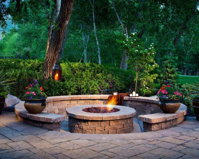 A Firepit Enhanced by Shrubs and Flowers | Awesome Firepit Area Ideas For Your Outdoor Activities