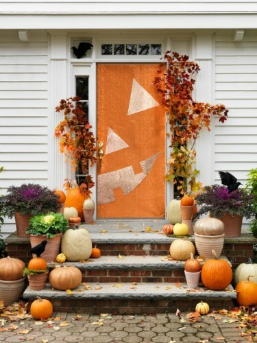 Halloween Door Decoration Ideas: Half a Pumpkin Halloween Door Idea