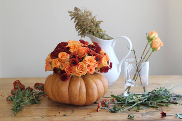 Roses, Mums & Broom Cob in a Pumpkin Vase | Best DIY Fall Centerpiece Ideas | FarmFoodFamily.com