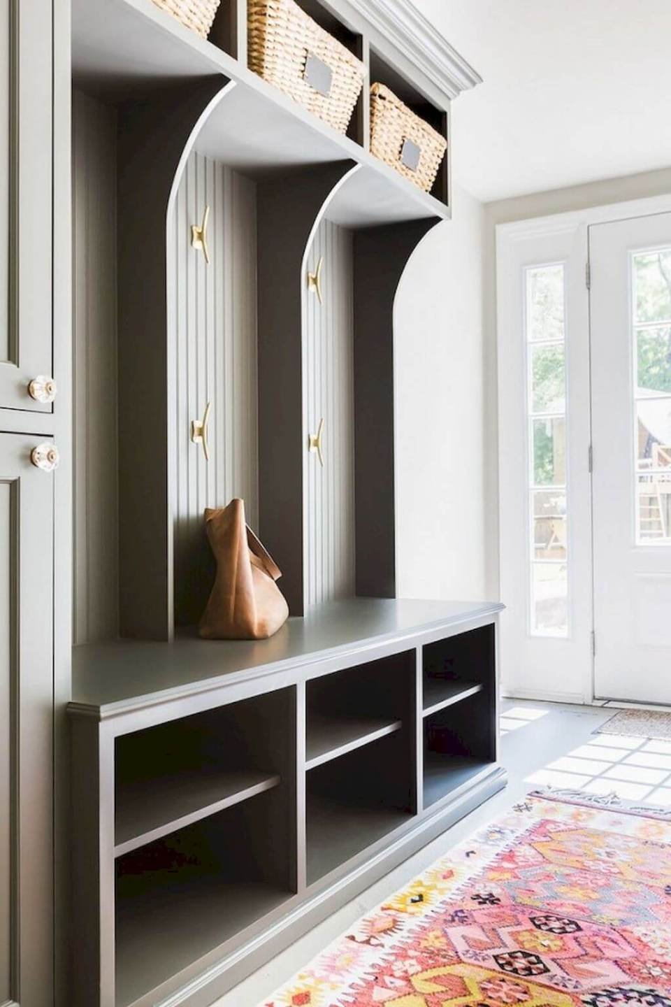 A linen closet with storage | Best Small Entryway Decor & Design Ideas | Small Mudroom Ideas | FarmFoodFamily.com