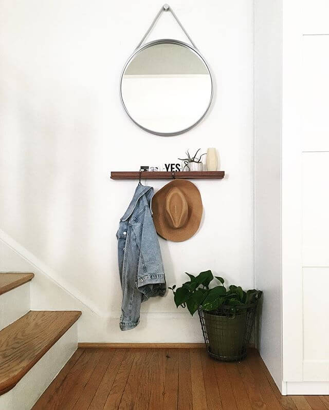 Wooden shelf with coat hooks and a mirror   Best Small Entryway Decor & Design Ideas   Small Mudroom Ideas   FarmFoodFamily.com