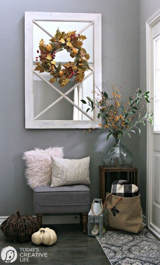 A mirror with bench | Best Small Entryway Decor & Design Ideas | Small Mudroom Ideas | FarmFoodFamily.com