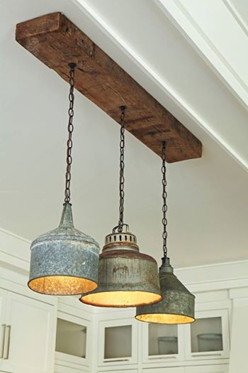 Rustic light fixture is made from old tin funnels   Trending & Vintage Porch Lighting Ideas & Designs   FarmFoodFamily.com