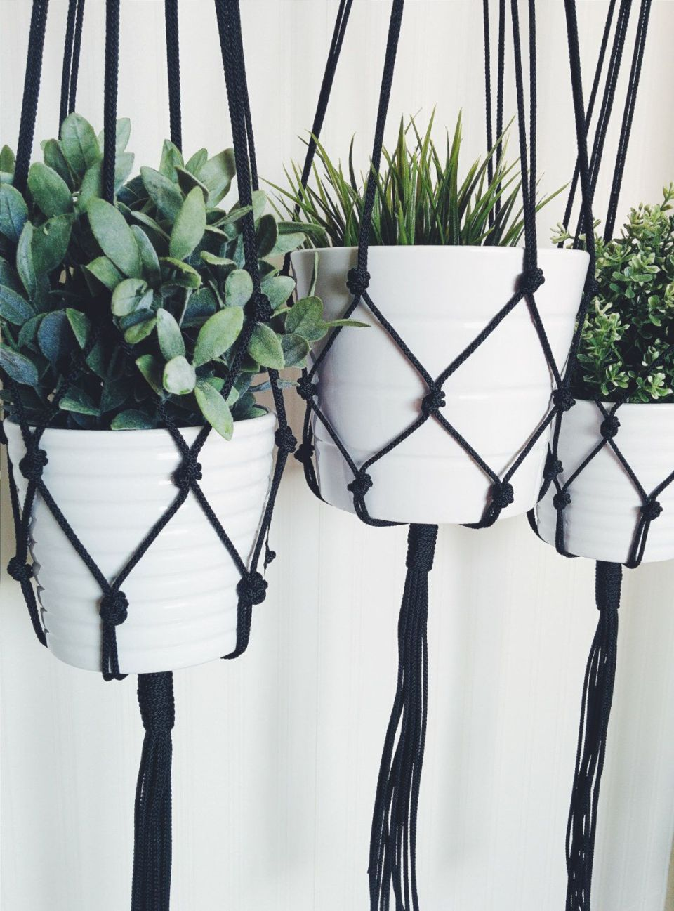 Black macrame flowerpot for hanging plants
