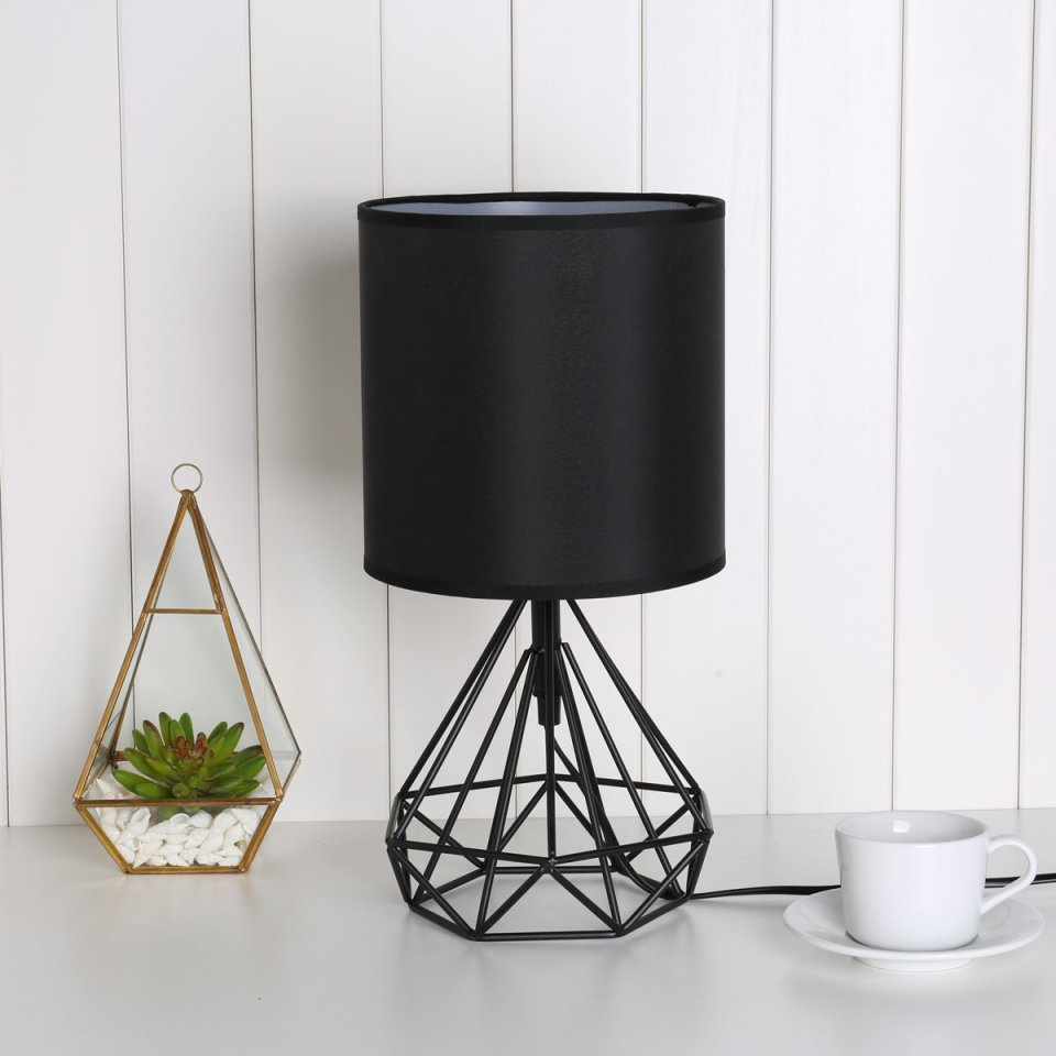 Geometric lamp of black color and golden terrarium