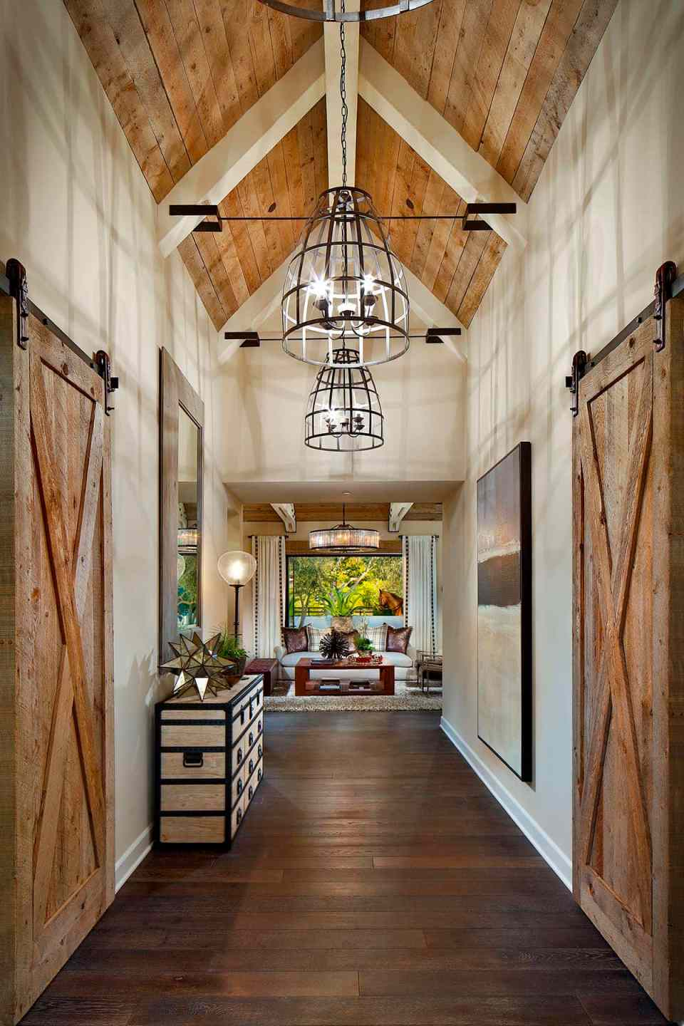 A large hallway with light fixtures, and wood sliding doors