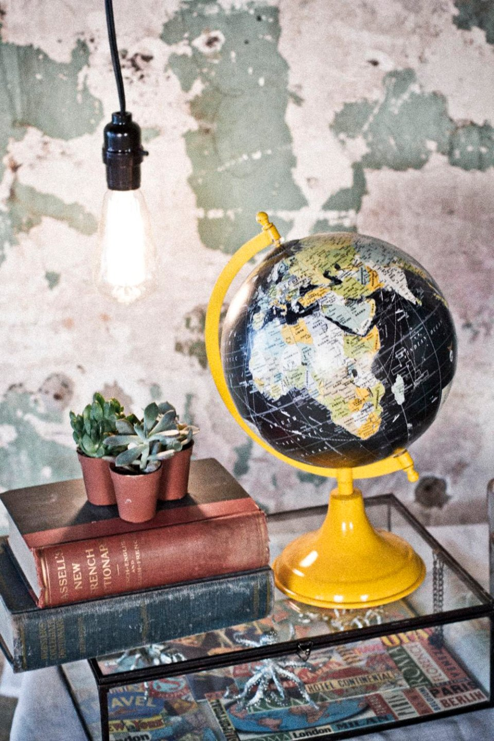 Black globe on a yellow base