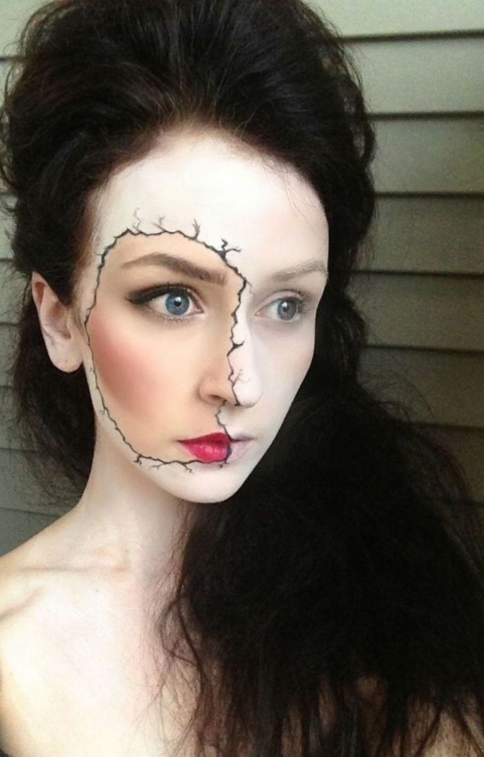 Girl with makeup for halloween girl with double face