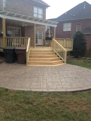Stamped concrete patio with deck