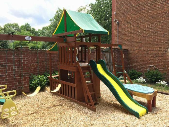 A Backyard with Rowhouse Play Space