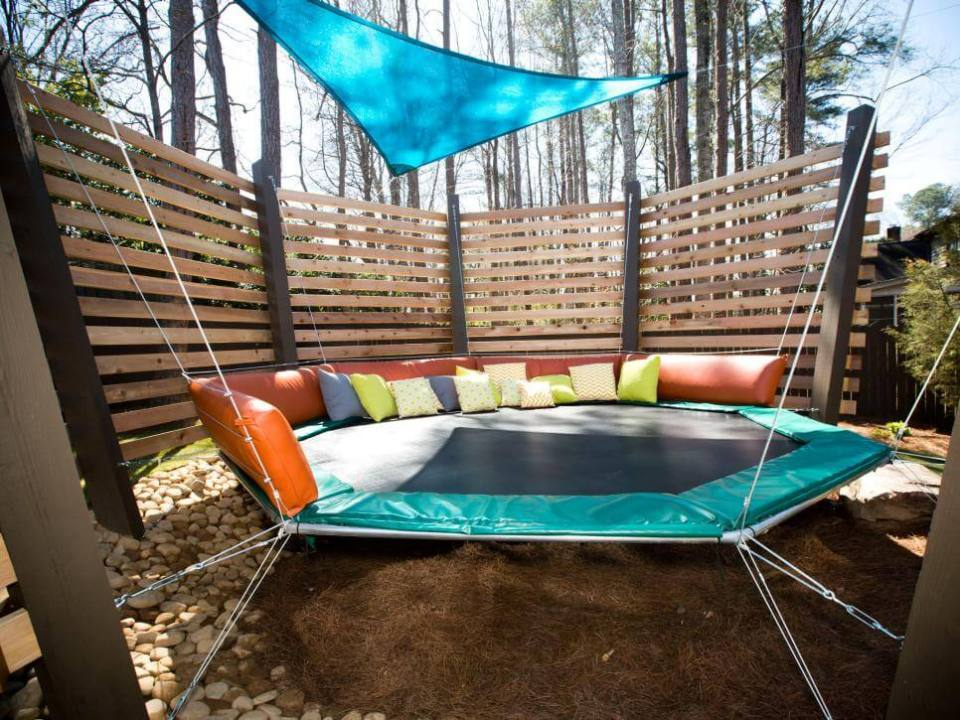 A Backyard with a small Trampoline