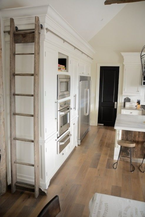 Farmhouse kitchen with library ladder
