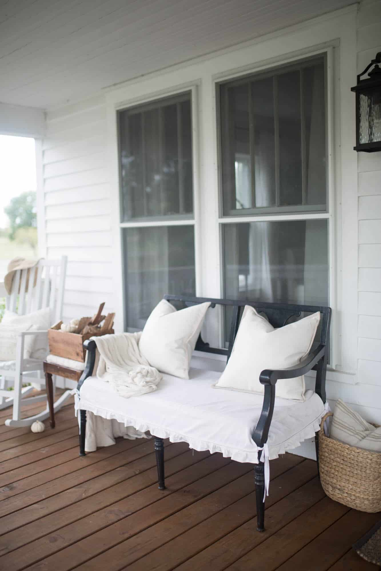 Fall Farmhouse Front Porch Decor with slipcovered bench