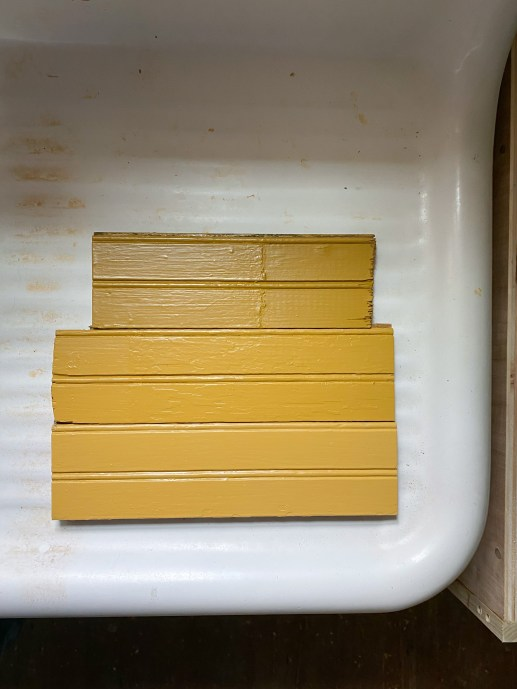 three yellow dark paint colors