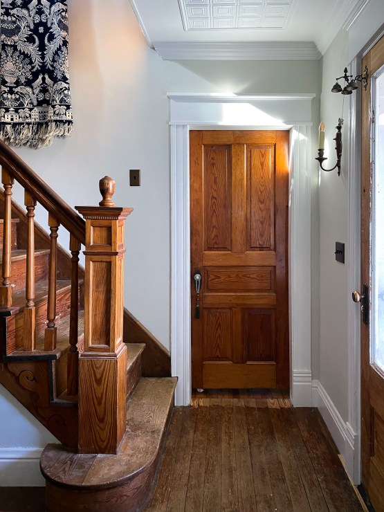 neutral hallway with orange trim