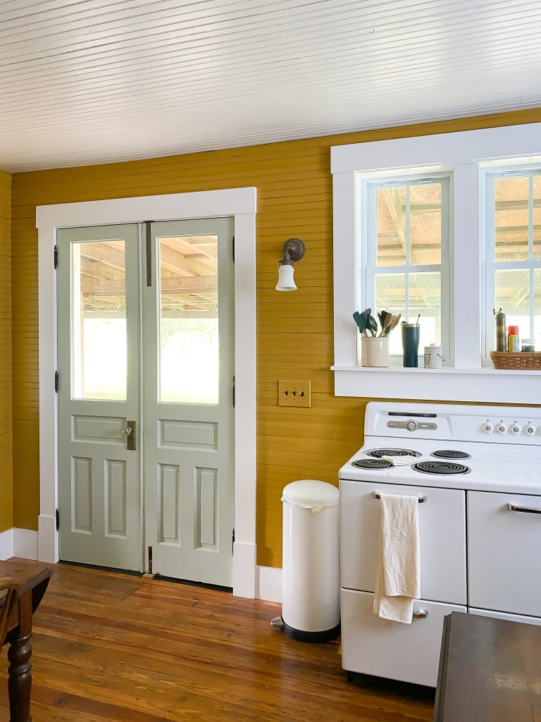 antique stove and green doors