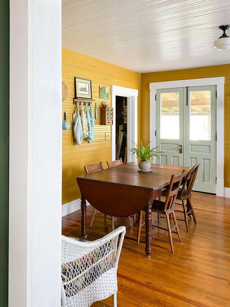 kitchen table with green doors