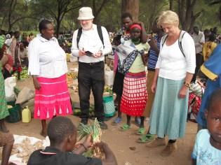 Helena, Martin and Henrietta discuss crops at Market