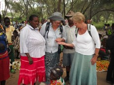 Helena, Alex and Henrietta discussing finger millet