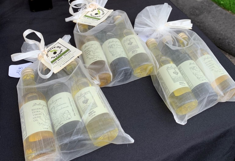 Gift bags flavored vinegar and olive oils with dried herbs