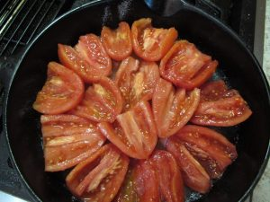 Tomatoes laid in concentric circle for tarte