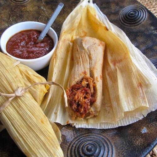 Open tamale showing the inside filling