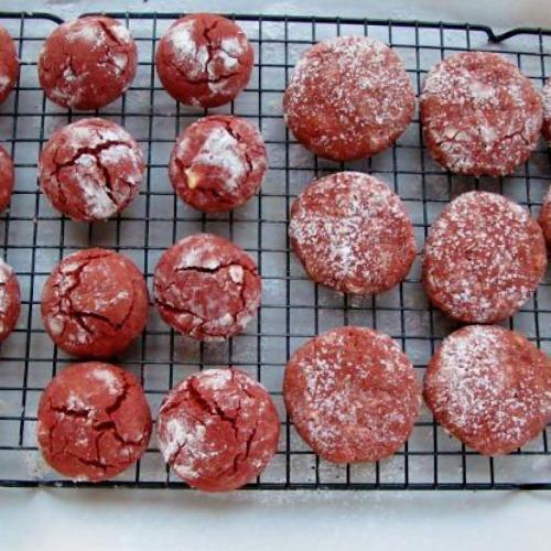 Red velvet crinkle cookies cooling on rack