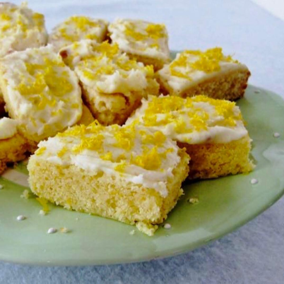 Plate of lemon blondies with Limoncello Icing