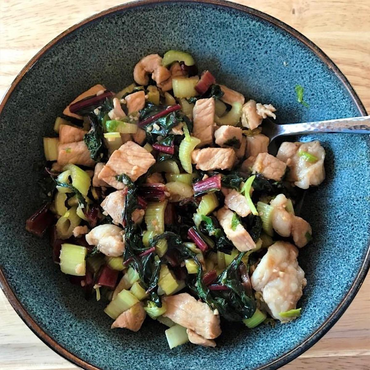 Low carb stir fry made with pork and swiss chard