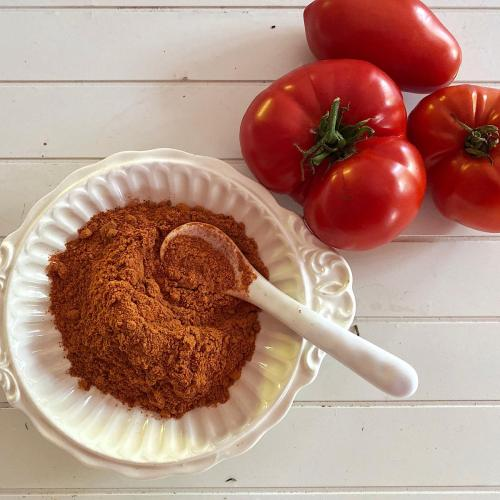 Bowl of tomato powder and 3 heirloom tomatoes