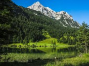 Mountains, lakes and vibrant greens in the German Alps.