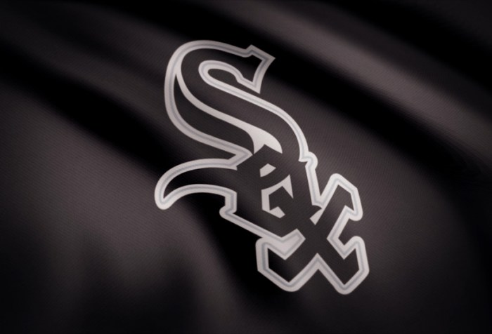 Waving flag with Chicago White Sox professional team logo. Close-up of waving flag with Chicago White Sox baseball team logo, seamless loop.