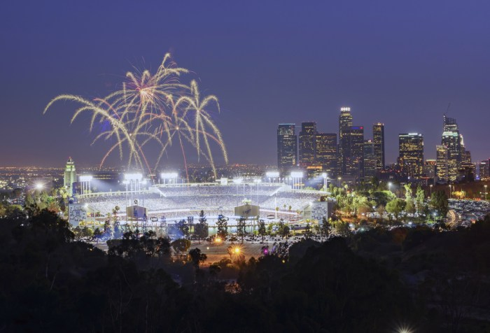 Fireworks over Dodger Stadium with view of downtown skyscrapers