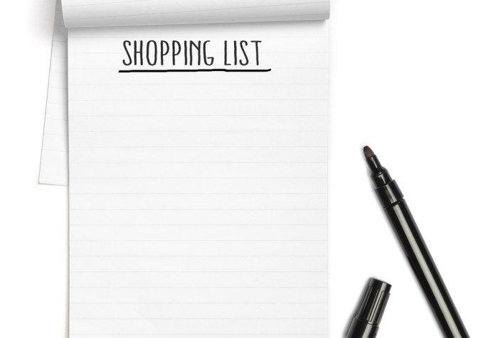 Shopping List on note book with black pen, with copy space, isolated on white background