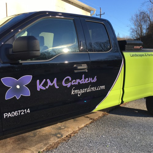 Km gardens custom vinyl door lettering and logo with pin striping and green color change wrap