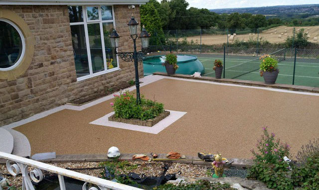 Farrelly Construction Resin Patio with light border