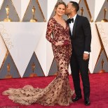 Chrissy Teigen in Marchesa dress with John Legend