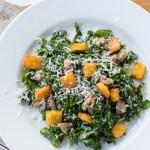 Kale Caesar Salad with Polenta Croutons and Sausage