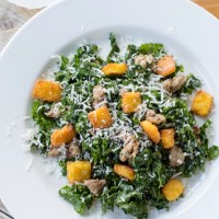 Kale Caesar Salad with Polenta Croutons and Sausage