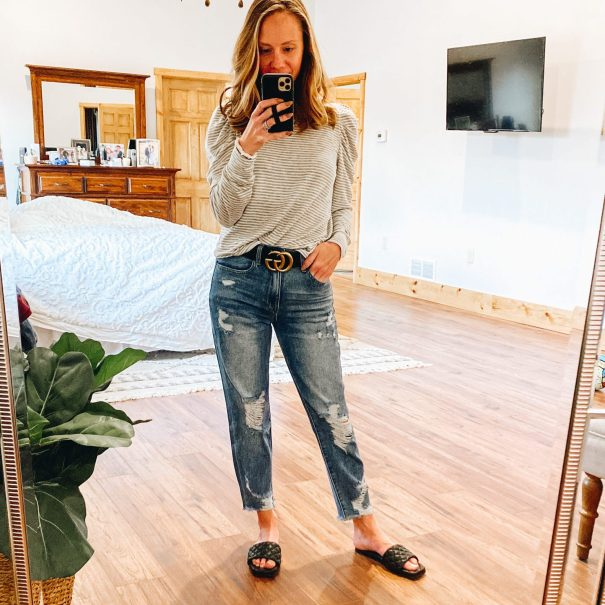 Top 7 Cute Spring Sandals for Women featured by top Pittsburgh fashion blogger, Fashionably Late Mom.  Spring Sandals by popular Pittsburgh fashion blog, Fashionably Late Mom: image of a woman wearing a black and white stripe puff sleeve top, deconstructed denim, and black slide sandals.