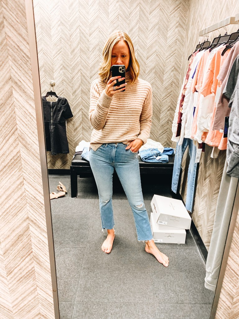 Nordstrom Anniversary Sale 2021: Try On Edition featured by top Pittsburgh fashion blogger, Fashionably Late Mom   Nordstrom Anniversary Sale by popular Pittsburgh fashion blog, Fashionably Late Mom: image of a woman wearing a Nordstrom tan and brown strip sweater and light wash fray hem jeans.