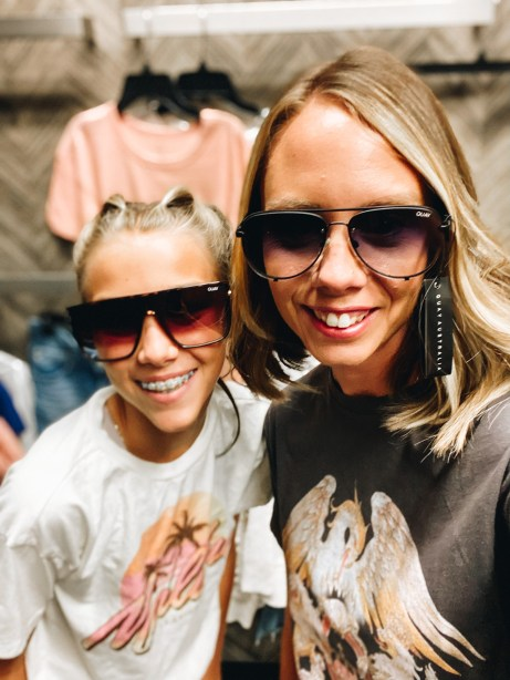 Nordstrom Anniversary Sale 2021: Try On Edition featured by top Pittsburgh fashion blogger, Fashionably Late Mom   Nordstrom Anniversary Sale by popular Pittsburgh fashion blog, Fashionably Late Mom: image of a woman and her teenage daughter wearing a Nordstrom designer sunglasses and graphic t-shirt.