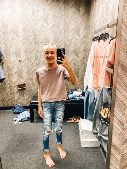 Nordstrom Anniversary Sale 2021: Try On Edition featured by top Pittsburgh fashion blogger, Fashionably Late Mom   Nordstrom Anniversary Sale by popular Pittsburgh fashion blog, Fashionably Late Mom: image of a teenage girl wearing a Nordstrom tan t-shirt and distressed denim.