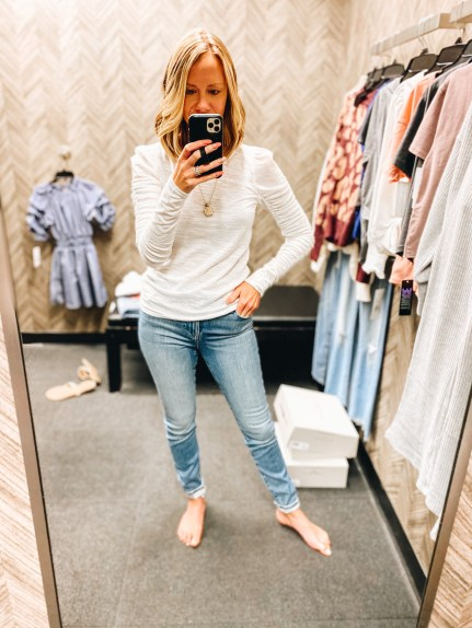 Nordstrom Anniversary Sale 2021: Try On Edition featured by top Pittsburgh fashion blogger, Fashionably Late Mom   Nordstrom Anniversary Sale by popular Pittsburgh fashion blog, Fashionably Late Mom: image of a woman wearing a Nordstrom white long sleeve shirt and light wash jeans.